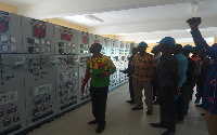 Eastern regional Manager of ECG Ing. Michael Baah at the workstation