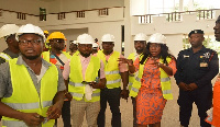 Catherine Afeku (second right) at the site of the Eastern Regional Theatre Complex