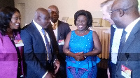 Mr. Kuuchi (2nd from left) interacting with the Minister, Ms. Dapaah (middle) with others looking on