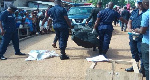 Police carrying a body. File photo