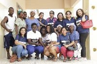 Executives of IWA, GOWA pose with health persons at the Akuse Hospital