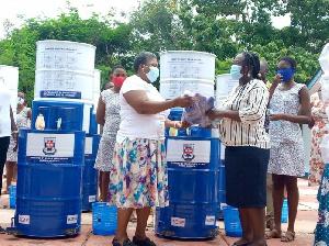 Mrs Betty Aduhene-Chinbuah, Headmistress of the school receiving the items,
