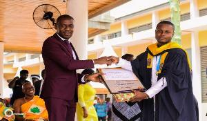 Mr  Kennedy  Awuah receiving his award