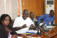 Mr. Asiedu (second from right), addressing the media.