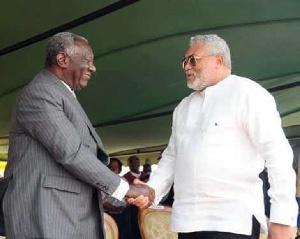 John Agyekum Kufuor exchanging pleasantries with Jerry John Rawlings