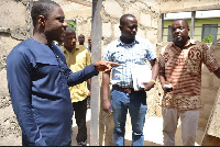 DCE for Kwahu East, Isaac Agyapong with others during their visit to an ongoing project site