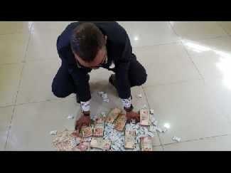 Obinim turns toffees into money