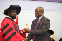 Paul Asare Ansah [L] receiving award at the global leadership conference