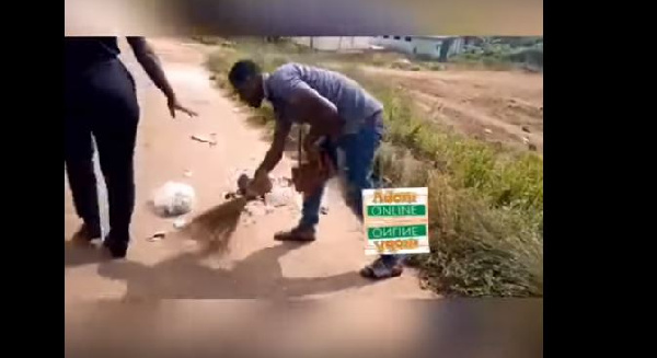 Tricycle rider punished to sweep for littering