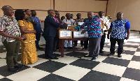 Mr. George Mireku Duker presents donations to GES representatives