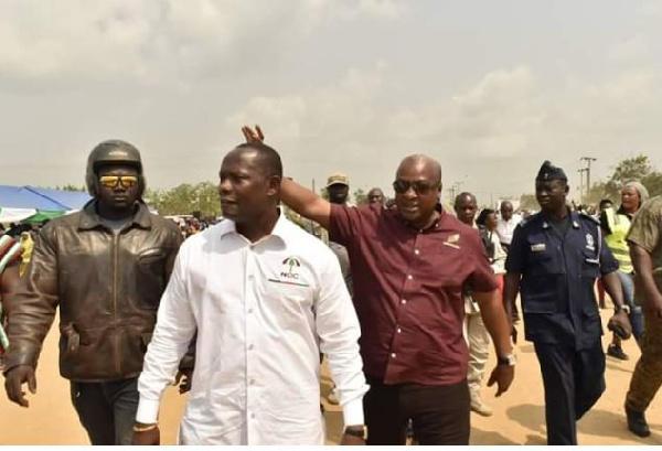 Former President John Dramani Mahama waves constituency members