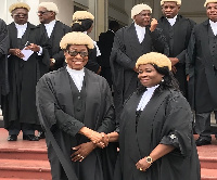 Justice Sophia Akuffo, the Chief Justice in a handshake with Justice Sophia Adinyira