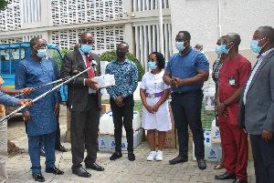 George Swanzy Winful presenting the medical items to the various health representatives