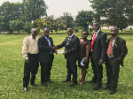 Prof Baiden (2ndL) receiving the package from Ackorful, with them are staff of the bank