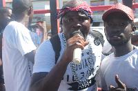 Bukom Banku with a fan