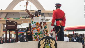 The new president Nana Akufo-Addo waving a Ghanian traditional gold sword during the inauguration