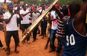 Hooded supporters of the ruling New Patriotic Party (NPP) in the Northern region brandishing sticks