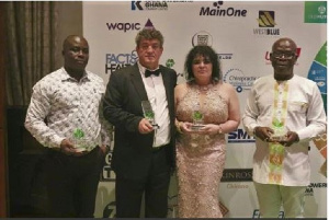Adriano Sobriera (2nd left) joined by other management members to display their awards