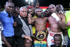 George Ashie with the WBO title strapped on his waist