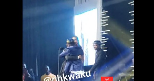 Shatta Wale hugs Stonebwoy's representative who took the award on him behalf