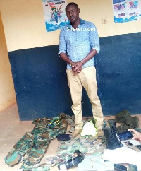 Issah Abdul Mubarik arrived at the police station in a military uniform to hand over a 'suspect'