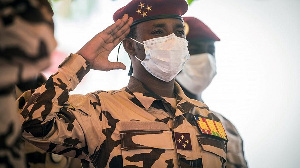 A photograph of a Military man saluting