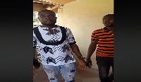 The fake spiritualists handcuffed
