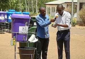 Dr Josephat Nyuzaghl demonstrating proper handwashing
