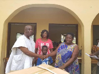 MCE for Birim Central, Kwabena Bempong presenting items to the physically challeged