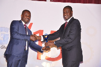 Mr. Solomon Lartey (right) presenting one of the awards to SMEs at the ceremony