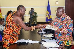 President Nana Addo Dankwa Akufo Addo Receiving Documents From Nana Otuo Sriboe Chairman Of The Coun