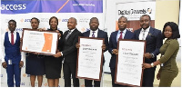 Chief Operating Officer of Access Bank Ghana, Mr. Ade Ologun, others receiving the certificate