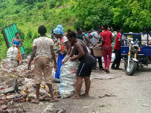 Some residents from nearby communities fetching' the assorted drinks