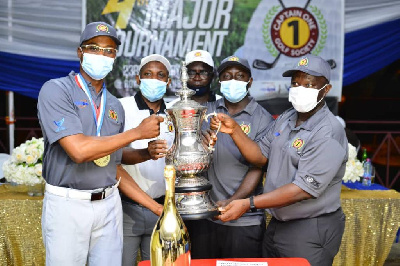 Torgah (left) receiving the trophy from Appiah (second left) and other executives