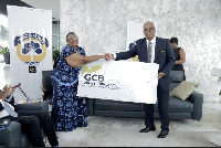 MD of GCB, Mr Anselm Ray Sowah presents the cheque to Prof Esi Sutherland-Addy
