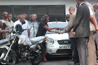 Lydia Alhassan presenting the keys to the automobiles to Prof Oduro Owusu