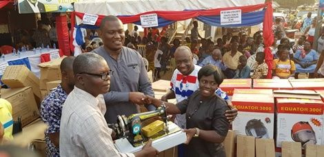 Dr. Nana Ayew Afriyie donates a sewing machine to one of the constituents
