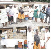 Mrs. Newman (4thL), Director of Operations of the 'Rebecca Foundation' presenting the items