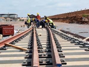 Railways Workers Maintaining A Rail Line 750x563
