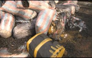 Large amount of marijuana packed in black polyethylene were concealed under the charcoal