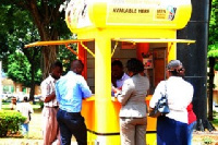 Mobile Money vendor serving customers (File Photo)