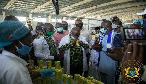 President Nana Akufo-Addo sipping Eku juice at the factory