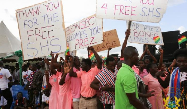 Students with placards in praise of Free SHS