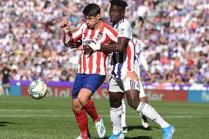 Ghana international Mohammed Salisu tackling Atletico Madrid striker Alvaro Morata