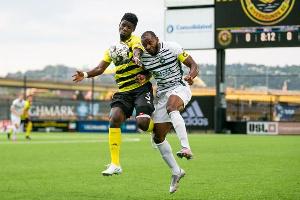 Ropapa Mensah (yellow) battling for the ball