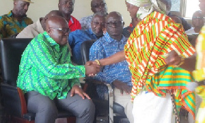 Prez Akufo-Addo in a handshake with Beposo Queenmother