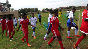 Ashtown ladies in red and Kumasi Sports Acadamy in white and blue