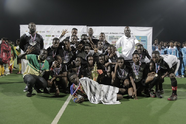 Players and officials of Adisadel College displaying the 2019 trophy