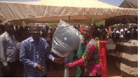Awudu Kombian (R) receiving his reward
