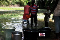 Children in Ekumfi in Central Region walk a distance to fetch water from a dirty pool.